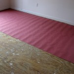 Project E: Laying down a barrier on the subfloor
