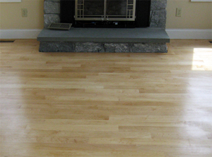 refinished hardwood floors by fireplace